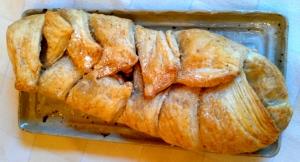 "Dice 3 small organic Gala apples and 2 organic figs. Melt about 1 tbsp. of organic coconut oil in pan over medium heat. Saute fruit adding about 2 tsp. each organic cinnamon and coconut sugar. Cook until soft, about 8 mins. Add 1/3 cup sliced almonds and cool. Meanwhile defrost package of puff pastry. Roll into about 9"" x 12"" rectangle. Place filling in centre and roll or braid. To braid, slice dough away from filling on both sides of pastry then alternate strips to cover filling. Brush pastry with melted coconut oil and bake in 350° oven until pastry is puffed and golden, about 20 mins."